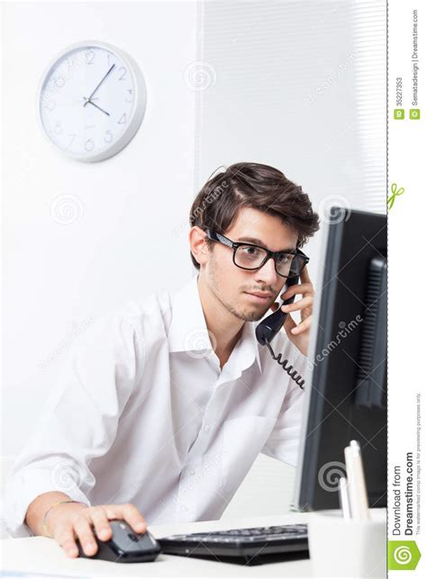 on the phone working in office on the phone stock photos image