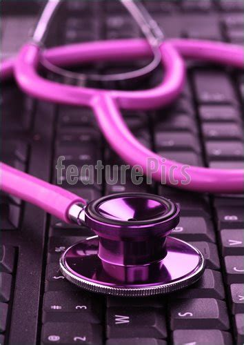 medical supplies pink stethoscope  keyboard stock
