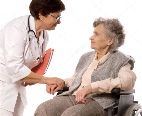health care worker helps elderly woman stock photo
