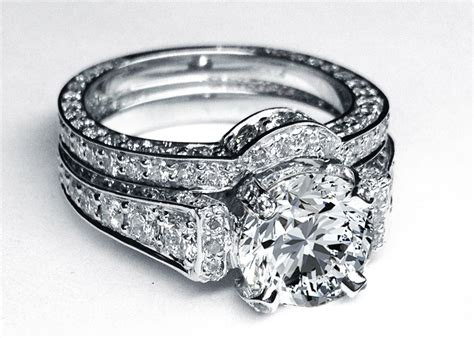 large  diamond cathedral graduated pave engagement