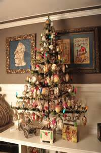 beautifully decorated feather tree with lights great vintage images in frames christmas