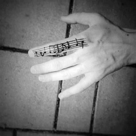 staff tattoo designs  men musical pitch ink