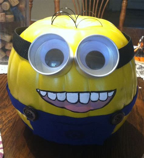 how to make a minion pumpkin here s an awesome halloween decorating idea paint a real or fake pumpkin light green and turn