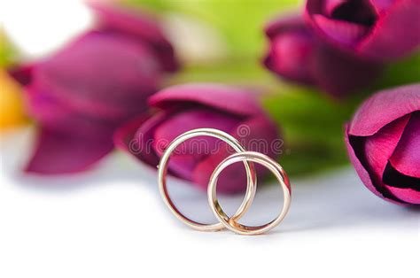 the wedding rings and flowers isolated white background image of jewelery