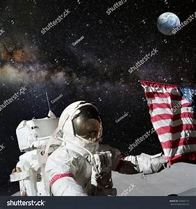 Astronaut Holding American Flag On Lunar Stock Photo ...