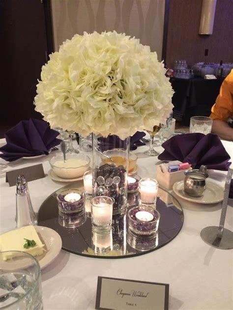diy silk floral and candle centerpiece weddingbee photo