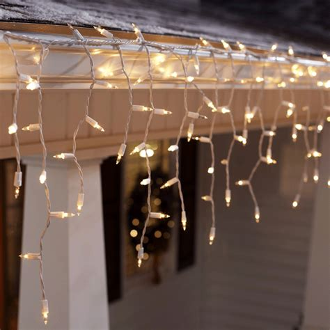 how to put christmas lights on house tips for hanging outdoor christmas lights