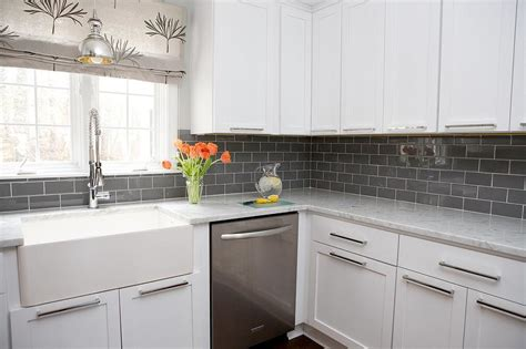 white kitchen cabinets  gray subway tile backsplash