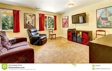 Tv Living Room With Art And Red Curtains Royalty Free