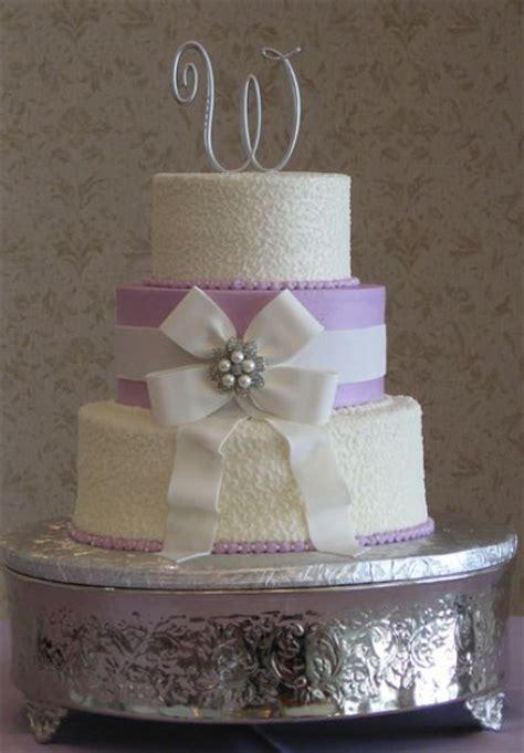 tier  white wedding cake  lavender middle white bow  monogram topperjpg