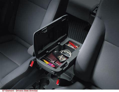 drivers side armrest  storage   element