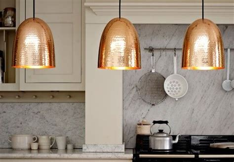 copper pendant lighting above a kitchen island shaker