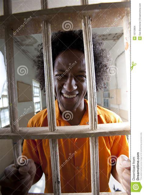 happy man  prison cell stock photo image