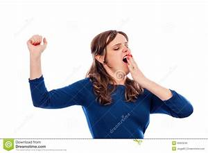 Tired Young Woman Yawning And Stretching Her Arms, Bed ...