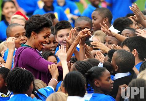 First Lady Michelle Obama and local school children ...