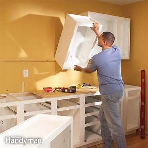 installing kitchen cabinets the family handyman With kitchen cabinets lowes with how to hang wood art on wall