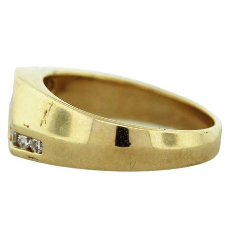 yellow gold diamond accented mens ring boca raton