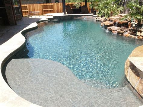 pebble sheen contemporary pool houston by blue pools
