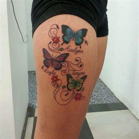 tatouage prenom femme tatouage femme prenoms 3 enfants avec papillons couleur fleurs et arabesque jpg 720 215 720