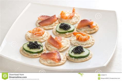 canapé 2places canape with seafood on the plate stock photo image 57836771