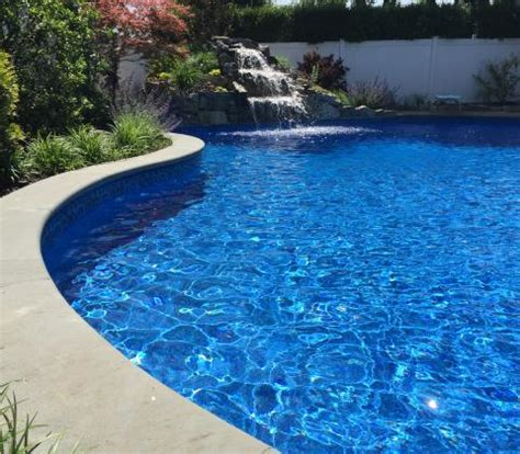 free form pool design with waterfall greenlawn