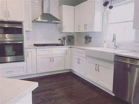 white kitchen  ebony jacobean hardwood floors