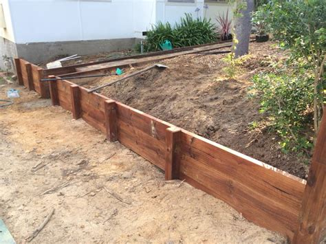 small timber retaining wall diy timber retaining wall in the making treated pine lengths with a jarrah stain diy ideas