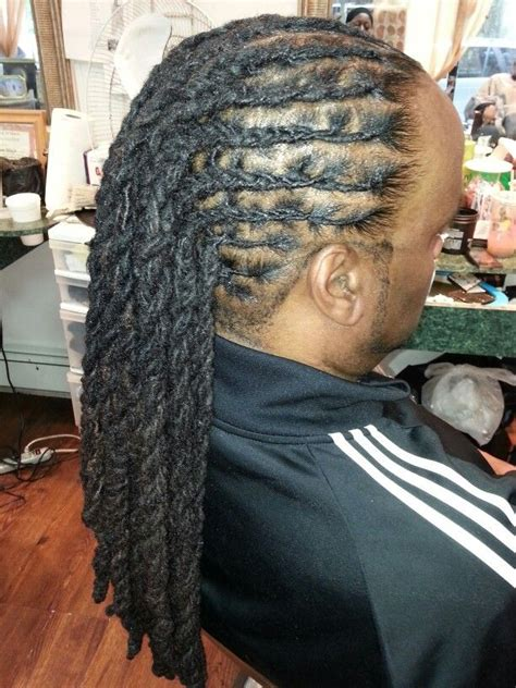 a hairstyle for men done by desmar in harlem ny my
