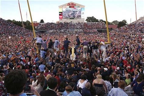 SEC fines Ole Miss, Kentucky after fans rush field ...