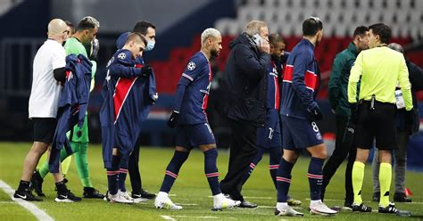 Soccer players walk out of match in Paris after referee ...