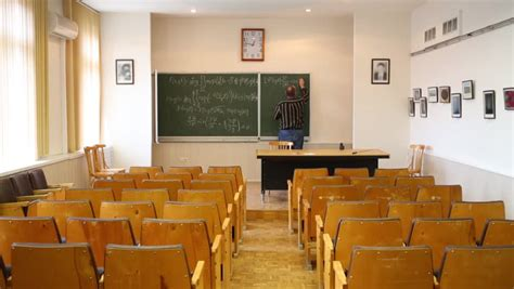 New Modern School Classroom With Chairs On Desks With Bid