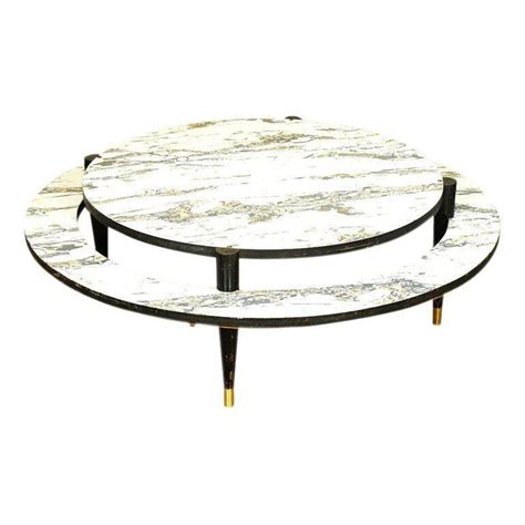 The most common mid century modern coffee table round material is metal. Mid-Century Modern Two-Tier Coffee Table | Round coffee ...