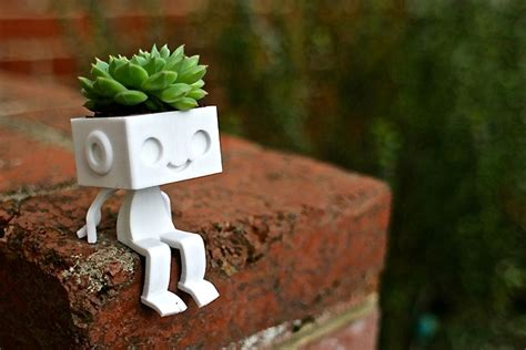 15 creative planter designs that would make any flower pot jealous
