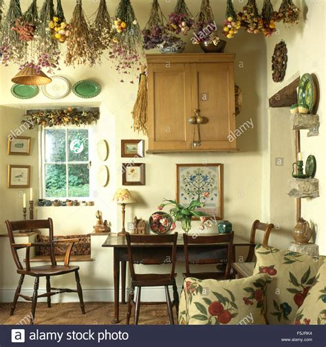 dried flowers hanging  ceiling  small cottage dining