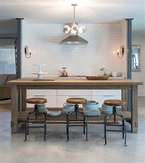 restoration hardware kitchen island salvaged wood center island with industrial bar stools transitional kitchen
