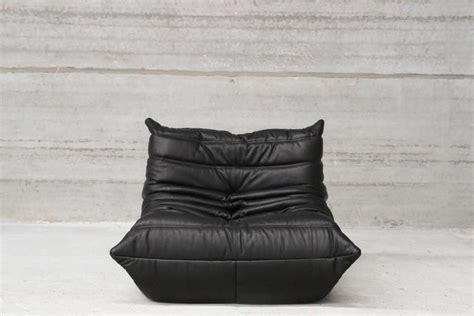 black leather lounge chair and ottoman by ligne roset