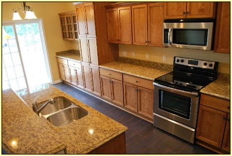new venetian gold granite with maple cabinets home