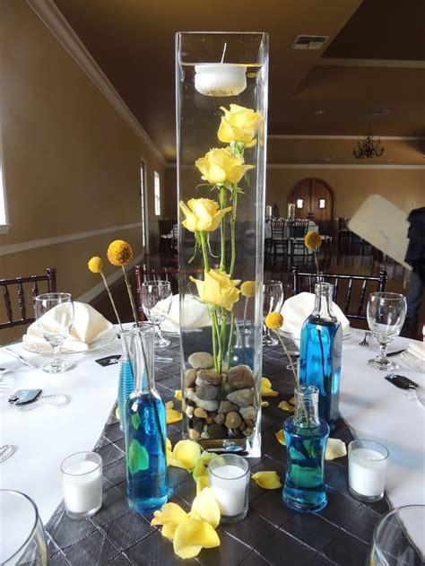 tall center piece wedding reception  water flowers