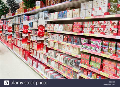 christmas cards and decorations on the shelves in a tesco