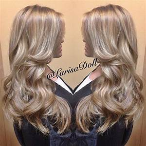 Medium ashy beige blonde base with full head of silver ...