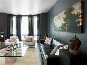 modern gray living room with bay windows and colorful