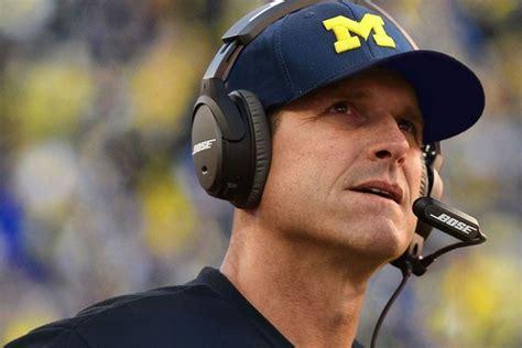 university  michigan football coach helps resolve