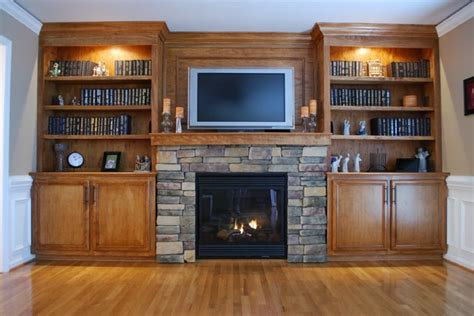 cabinets next to fireplace custom built in cabinets and stone surround fireplace