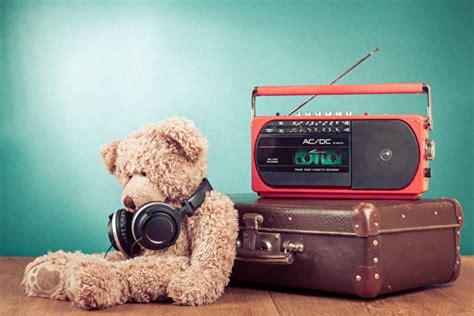 photo headphones radio suitcase teddy bear colored background