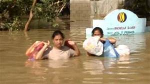 Philippines typhoons leave victims trapped by flooding ...