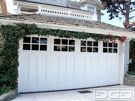 Garage Door Quieter by Traditional Carriage House Garage Doors Combined With