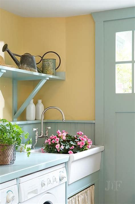 turquoise mudroom features mustard yellow paint on