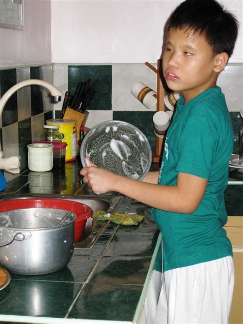 Doing the washing up at home in the Philippines