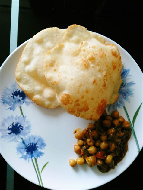 Crispy yet soft bhatura bread is typically paired with spicy chole and served as breakfast and. Homemade Chole Bhature : food