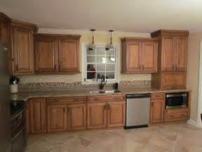venetian bronze kitchen faucet kraftmaid jamestown maple deaton traditional kitchen